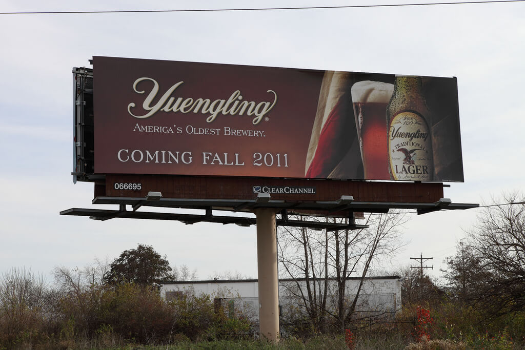 Billboard advertisement for beer.