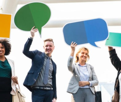 People holding up thought bubbles represents the importance of review management.
